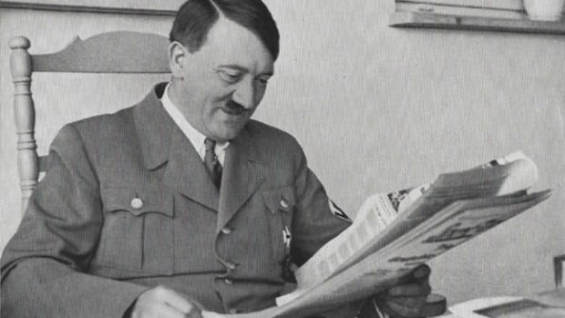 After the rise of the Nazi power, the the Völkischer Beobachter became the Party's official newspaper. Here, Adolf Hitler smiles as he reads the news in the Beobachter — his favorite newspaper.