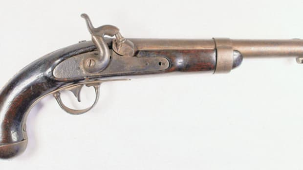 When I was ten years old, I purchased a very rough Model 1836 Pistol. It had been found lying on the ground. One side of the stock was rotted. The pistol had been converted from flintlock to percussion.
