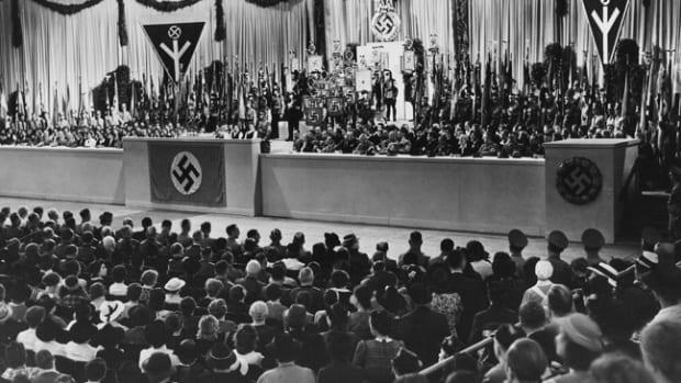 The NS-Frauenschaft empowered women to take part in the national movement as it swept over Germany. This photo was taken at the NS-Gaufrauenschaft Berlin rally in the Sportpalast. It shows Reichsfrauenführerin GertrudScholtz-Klink standing with (from left) Joseph Goebbels; the Italian Ambassador Dino Alfieri; Deutschen Arbeitsfront (DAF) leader Robert Ley; and the leader of the NS-Hauptamts NS-Frauenschaft, Erich Hilgenfeldt (Photo by Ullstein Bild via Getty Images)