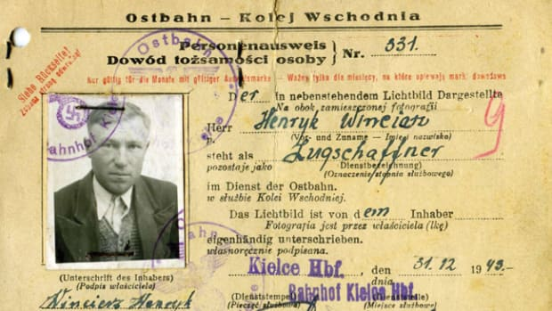 The obverse of the Ostbahn Personnenausweis identifies the holder, in this case, Henryk Wineiatz, a train conductor at the main train station in Kielce, a city in southeast Poland.