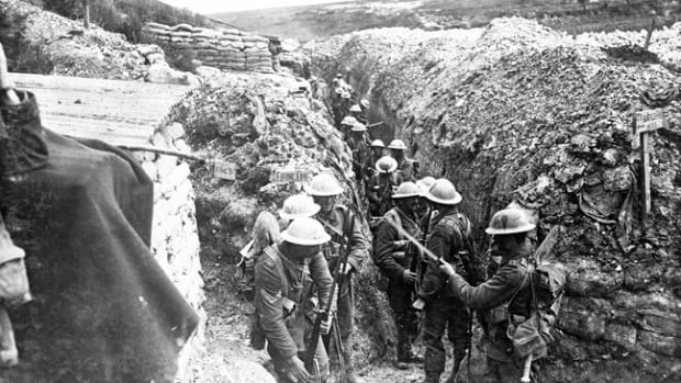 Early on the morning of 1 July 1916 at Beaumont Hamel men of the 1st Lancashire Fusiliers fix bayonets before proceeding to the front line. Trenches were named, many after London streets, and here the men stand in Esau's Way and will proceed to the left along King Street taking them to the British Front Line.