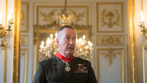 Marine Corps Gen. Joseph F. Dunford Jr., chairman of the Joint Chiefs of Staff, receives the Legion of Honor from French Gen. Pierre de Villiers, Chief of the Defense Staff in Paris, July 12, 2017. (DoD/Navy Petty Officer 2nd Class Dominique A. Pineiro)