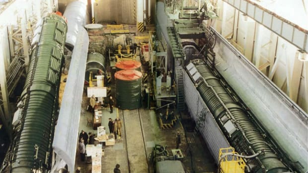 Loading of RS-22 missile in rail-mobile launcher