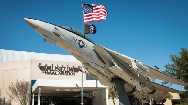 One of the prototypes of the famed F-14 Tomcat greets visitors at the entrance to the National Naval Aviation Museum. The museum also displays the last Tomcat to fly a combat mission, which came in the skies over Iraq.