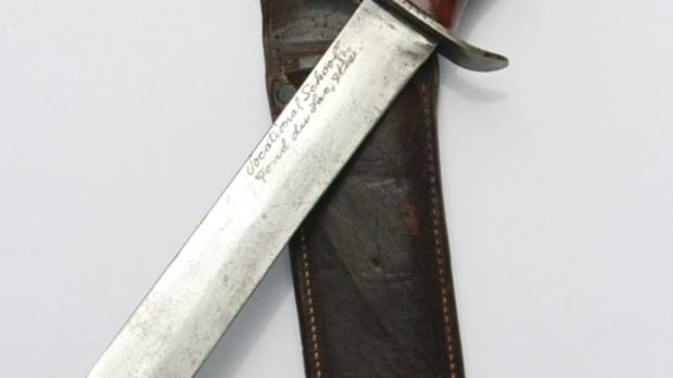 "During WWII, students at Wisconsin's vocational schools made personalized knives as part of the ""Knives for Servicemen"" program. The knife shown here was made at the vo-tech in Fond du Lac, Wisconsin. Becker Leather Goods Company of Fond du Lac donated the leather scabbards for the program's knives."