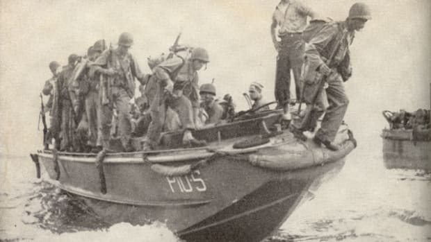 United States Marine Corps reinforcements at Guadalcanal debark from an LCP(L).
