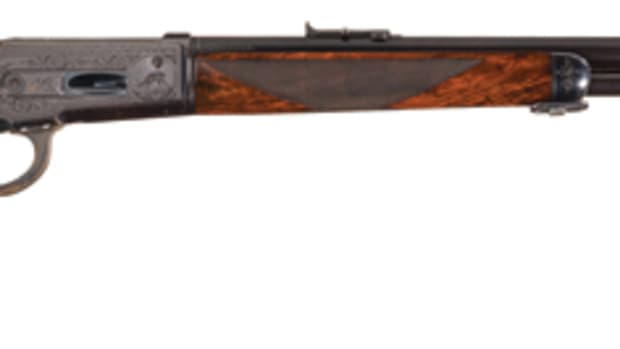 "Rare Collectors Firearms Auctions ""> Factory Engraved Winchester Deluxe Model 1886 Lever Action Rifle with Platinum Barrel Bands and Factory Letter"
