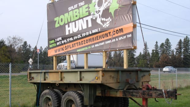 """An """"M17-1/2"""" trailer expertly made from an M35 that had been hit head-on placed along Minnesota Highway 5 entices visitors to an HMV-experience like no other."""