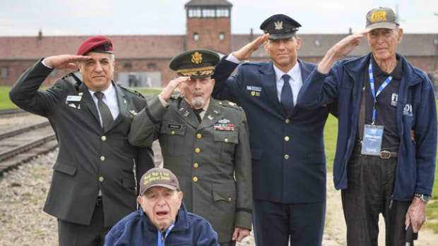(From left) FIDF National Director and CEO Maj. Gen. (Res.) Meir Klifi-Amir; Sid Shafner, 94, of Denver, Colo., who was one of the first U.S. soldiers to enter Dachau with the 42nd Infantry Division and was awarded two bronze stars for heroism; American liberator Col. (ret.) Cranston Rogers, 90, of Medway, Mass.; Head of Israel's Helicopters Air Division Brig. Gen. Yaron Rozen; and Lt. Col. (ret.) William Bryant Phelps, 90, of San Antonio, Texas, who liberated Mauthausen-Gusen with the 11th Armored Division, saluting while standing on the tracks leading to the Birkenau camp (Auschwitz II) in Poland.