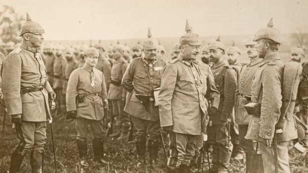 While giving final instruction before going into the fray, the King of Saxony is seen conversing with one of his men who has just received an Iron Cross.