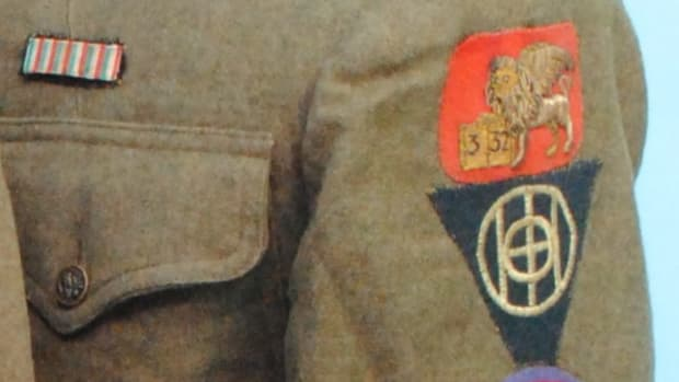 "The triple-decker stack of patches from the uniform service coat belonging to Elmer Thompson, a Doughboy serving in Company ""L"" of the 332nd Infantry Regiment."