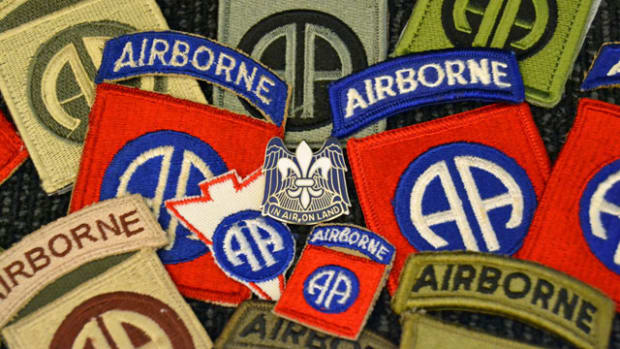 Variations of 82nd Airborne Division patches from World War II to present surrounding the division headquarters unit crest which was approved on 23 October 1942. The fleur-de-lis is representative of the division's battle honors earned in France during World War I. The wings are symbolic of the Division's mission as is the motto.