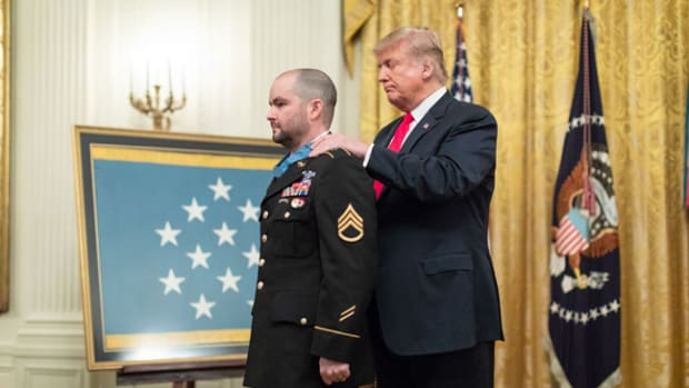 President Donald J. Trump presents the Medal of Honor to Retired U.S. Army Staff Sgt. Ronald J. Shurer II Monday, Oct. 1, 2018, in the East Room of the White House. (Photo Credit: Official White House photo by Shealah Craighead)