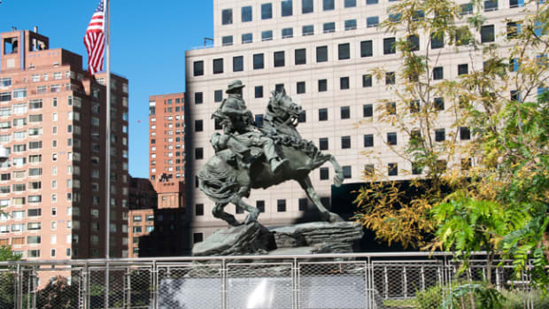 The America's Response Monument, aka Horse Soldier statue, sits in its final resting place at Liberty Park, adjacent to the 9/11 Memorial in New York City. The statue serves as a reminder of the bond formed between U.S. Special Operations Forces and the New York City first responders. (U.S. Army photo by Cheryle Rivas, USASOC Public Affairs.)
