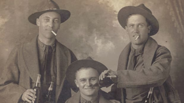 "Marked only with the words ""That last night in San Antonio,"" this group of happy 90th Division Doughboys certainly give the impression that they are well equipped with tobacco and alcohol, and ready to face the Kaiser's Army. They would get that chance soon enough at St Mihiel and in the Argonne."