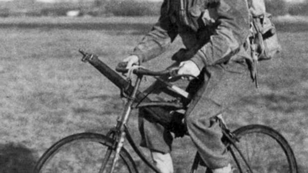 Often overlooked by many collectors, two-wheeled bicycles have played important roles in combat since before WWI. Here, a WWII British paratrooper uses a BSA folding-bicycle as an alternative to walking.