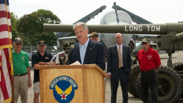 Surrounded by Vietnam veterans, Congressman Steve Israel dedicates the musuem's new Long Tom artillery piece that was part of the Kronlund armor collection - will now be seen by thousands. (American Airpower Museum photo)