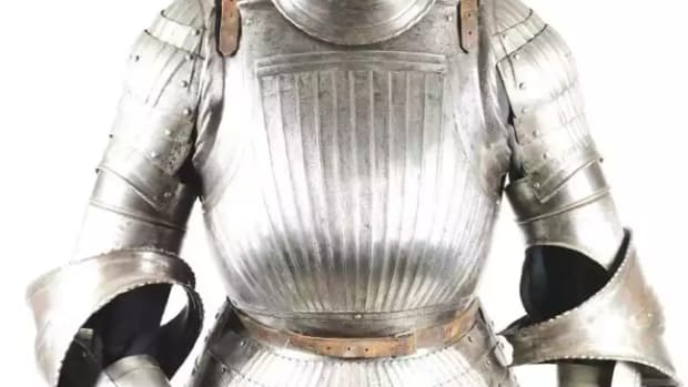 19th-century copy of a mid-16th-century German fluted armor likely from the atelier of the famous master armor dealer Ernst Schmidt. Neck lame of helmet struck with Nuremberg mark. Est. $25,000-$35,000