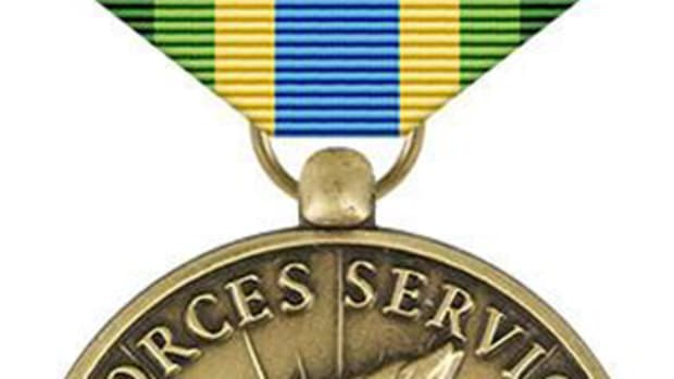 The Armed Forces Service Medal has a green, blue and yellow ribbon and a bronze medal featuring a torch like that held by the Statue of Liberty. U.S. Air Force graphic by Staff Sgt. Alexx Pons
