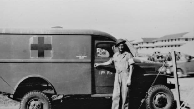 Barksdale Field, LA, summer 1941. Private (later Sergeant) Louis Sigrist with his newly arrived ride, a 1941 Dodge Army Air Corps Ambulance.