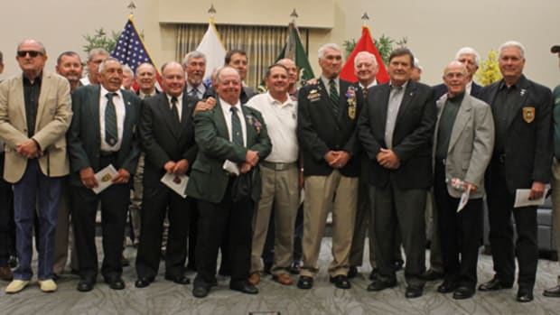 Retired Army Master Sergeant Patrick Watkins Jr., front row, third from right, stands with fellow veterans of the Military Assistance Command, Vietnam – Studies and Observations Group after being presented with the Distinguished Service Cross. Watkins was awarded the nation's second highest military honor in a ceremony May 22 in the 7th Special Forces Group (Airborne) Chapel.