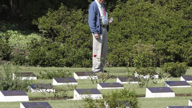 A former prisoner pays respect to fallen soldiers at the Commonwealth War Graves in Yokohama, near Tokyo