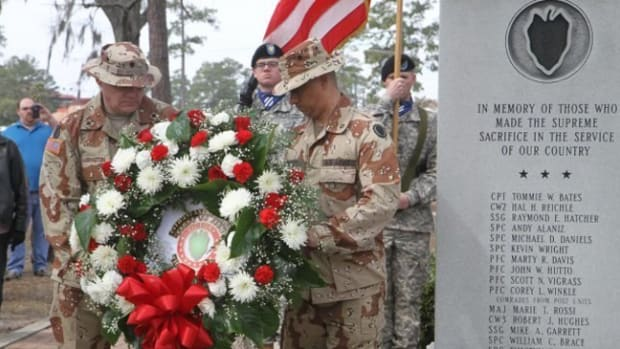 Gulf War Veterans lay wreath at 24th ID Desert Storm Memorial (PRNewsFoto/Veterans of the 24th Infantry)