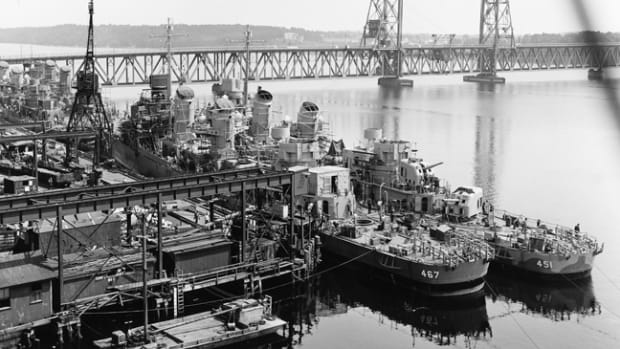 Following her launching on May 17, 1942, Strong was moved to Bath Iron Works' fitting-out basin for completion. Seen here tied up inboard of her sister ship Chevalier (DD-451). The two ships would find themselves even closer in a fateful Battle for Kula Gulf on July4-5, 1943. (National Archives, Courtesy of Mr. Stephen Harding)