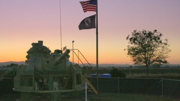 Sunset over the Museum. In the foreground a ?Training Hull? for an M60 Tank