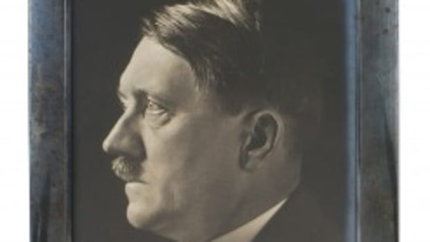 "The photo signed by Hitler was an autographed studio portrait, taken by the German leader's personal photographer, Heinrich Hoffmann. It showed a side profile of the subject wearing a civilian coat and tie. It was signed lower right in black ink, ""Adolf Hitler,"" with no personalized message. The 8-1/2-inch by 10-3/4-inch photo was in a frame engraved ""1940."" It sold for $3,840."