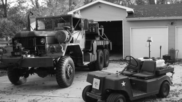 "The author's M816 Medium Wrecker with its ""Little Cousin"" sitting next to it. With a 15-gallon capacity spray tank on the rear deck along with lifting straps and a can of ether in the cup holder on the front, the little rig is ready for work!"