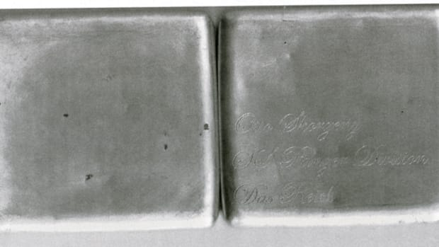 "The well-used aluminum cigarette case is engraved on the lower left corner, ""Otto Skorzeny / SS Panzer Division / Das Reich."""