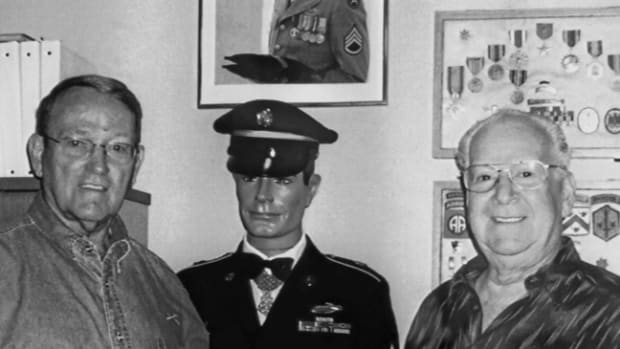 "LTC (Ret) John ""Jack"" Angolia (right) with Col. Roger Donlan (left), the first recipient of the Medal of Honor during the Vietnam War. The mannequin in the center is clothed with the uniform of M/Sgt. Jerry K. Crump, Medal of Honor recipient during the Korean War."