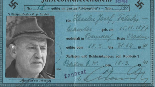 This annual fishing license for a German citizen is printed on blue, medium card stock, measuring about 15cm x 10cm. The document has a postcard-style format. This particular license was issued on 15 November 1941 by the district administrative office to 42-year old Josef Hessler, a factory worker in the town of Berndorf in the district of Baden near Vienna (Kreis Baden bei Wien) in the Reich Province of Lower Danube (Reichsgau Niederdonau). There was a 3 Reichsmark fee for the license.