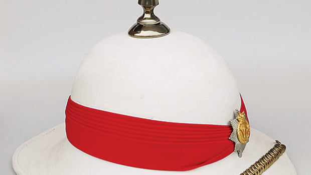 "This modern ""Wolseley"" Pattern helmet is still used by the Royal Canadian Regiment on the parade ground. Externally it looks little different from the cork helmets that were introduced more than 100 years ago, but in fact it is made of fiberglass!"
