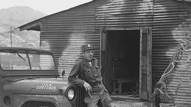 Sgt. Schmalengerger, a friend of Schramm's, leaning on an M38A1, Korea, 1951.