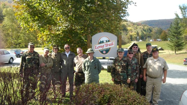 Historic military vehicle owners at a stop at Long Trail Microbrewery. The Brewery Encampment is an event that builds club camaraderie.
