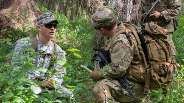 Capt. Darren Guree and Sgt. 1st Class Bryan Dennis of 112th Signal Batt. (Special Operations) (Airborne) - Special Operations Command Pacific, Signal Support Det, discuss the team's progress during Hammerhead Field Training Exercise/Situational Training Exercise 17-2, March 30, 2017. Capt. Darren Guree, left, is wearing the pixelated Universal Camouflage Pattern uniform. (U.S. Navy photo/Cynthia Z. De Leon)