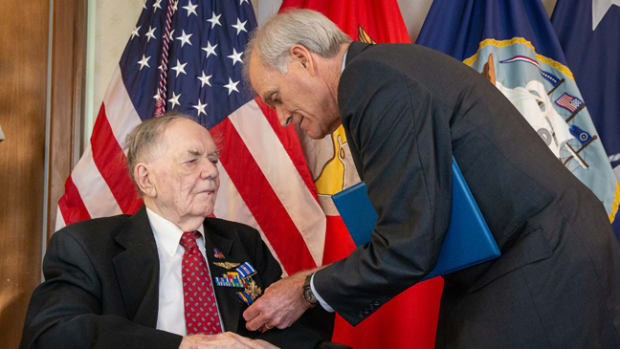 WASHINGTON (Sept. 10, 2019) Secretary of the Navy (SECNAV) Richard V. Spencer awards retired Aviation Machinist Mate 1st Class Bernard B. Bartusiak, 95, with two Distinguished Flying Cross medals and the Air Medal (Strike/Flight), 2nd-8th awards, for meritorious service during World War II involving aerial flight from April 20, 1943 to August 26, 1944. (U.S. Navy photo by Mass Communication Specialist 1st Class Paul L. Archer/Released)