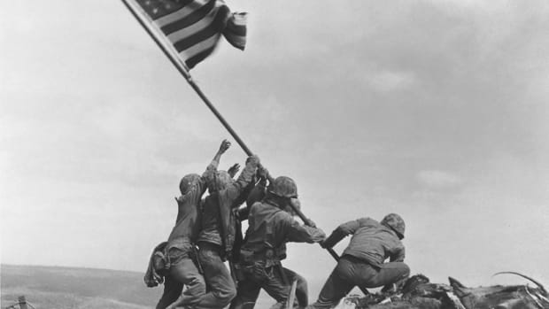 U.S. Marines of the 28th Regiment, 5th Division, raise the American flag atop Mt. Suribachi, Iwo Jima, on Feb. 23, 1945. (Joe Rosenthal/AP and retouched by by Alexis Jazz, via Wikimedia Commons)