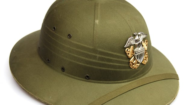 This early Hawley-produced helmet lacks the front grommet for the attachment of the insignia, and the crafty owner instead painted on the U.S. Navy insignia.