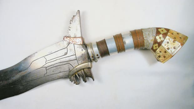 "Close up of the entire hilt showing the fancy trim of silver and mother of pearl of the ""Bloody Kris."""