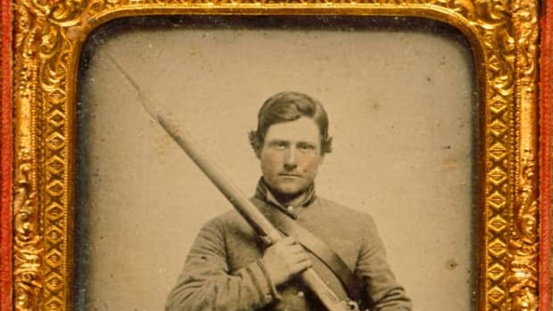 Cased ambrotype portrait of C.S.A. Corporal Anthony Sydnor Barksdale (1841-1923), taken 1861 with Mississippi rifle.