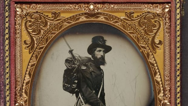 Private Albert H. Davis of Co. E, 9th New Hampshire Infantry Regiment with Model 1841 Mississippi rifle and sword bayonet.