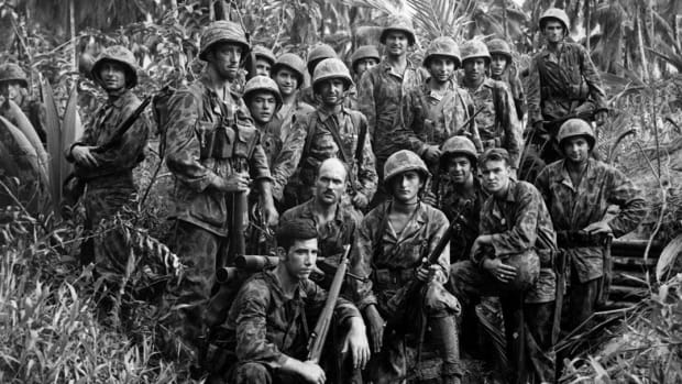 U.S. Marine Raiders pose in front of a Japanese stronghold they conquered at Cape Totkina, Bougainville in the Solomon Islands in January 1944.