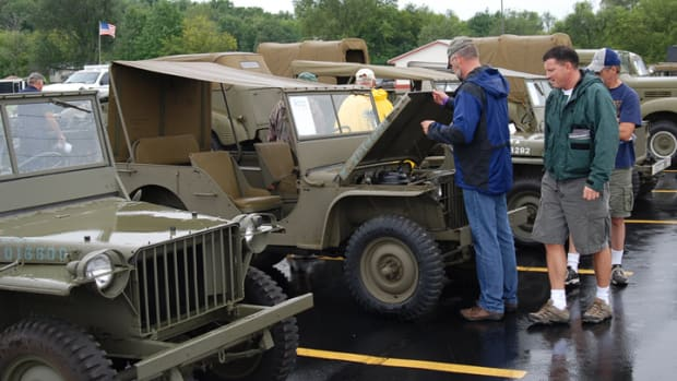 Potential buyer inspecting Jeep at the Chet Krause auction, 2010.