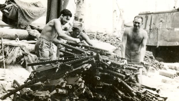"WWII press photo titled, ""Burned out guns from battling Japanese at Tarwawa"