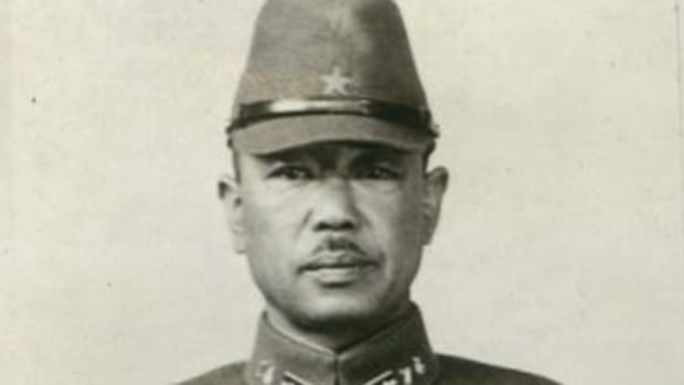 Snapshot of Japanese Infantry officer wearing field cap and Type 98 collar insigina.