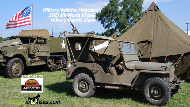 WWII Half-track, Jeep, US Flag, and pyramid tent with the two sponsors' logos in lower left corner.