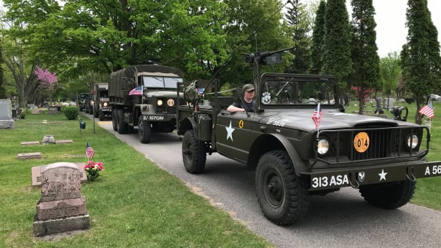 David Schwarz's 1967 M715, M35, and M725 touring a cemetery